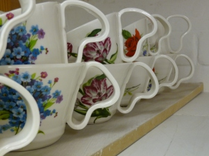 cups fresh out of the kiln